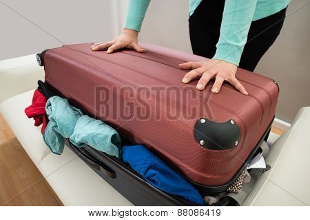 Close-up Of Woman With Suitcase