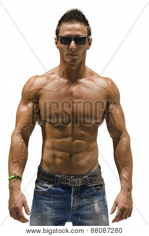 Attractive young man with naked muscular torso, wearing jeans, isolated
