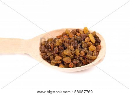 Wooden spoon with raisins.