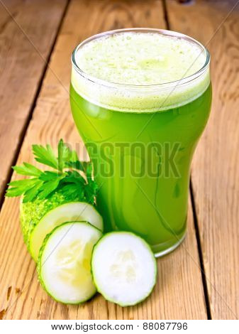 Juice cucumber in tall glassful on board