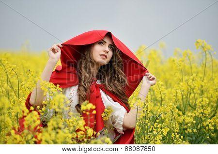 beautiful woman on blooming rapeseed field in spring