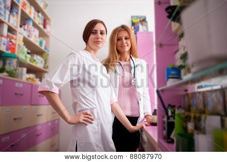 Two Young Pharmacist Inside Pharmacy