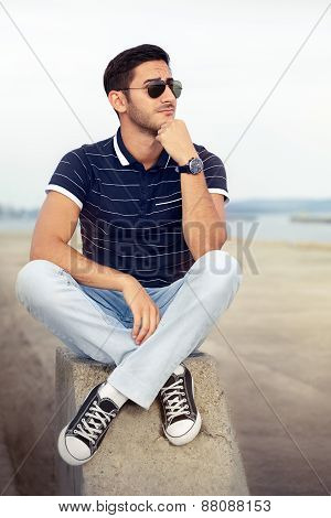 Young Man Thinking by the Water