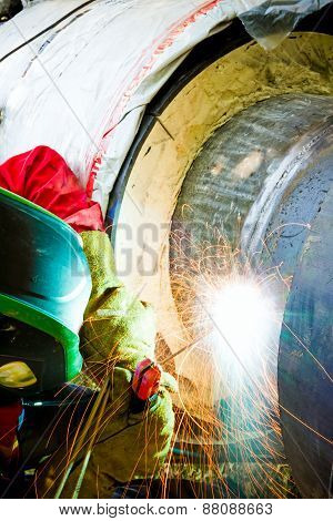 Close Up Shot Welder Until Welding, Sparks Flying Around.