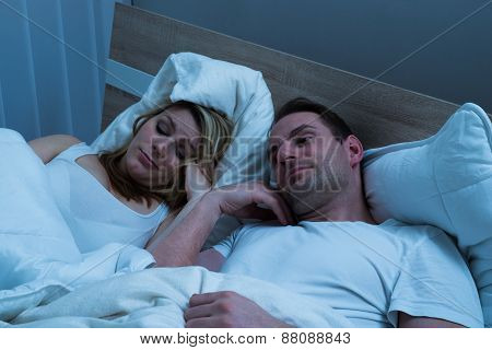 Bored Couple Lying In Bed