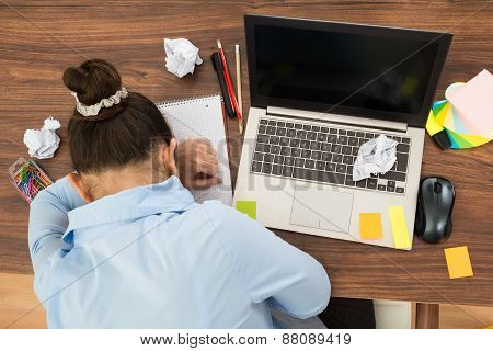 Businesswoman Doing Head Down On Desk