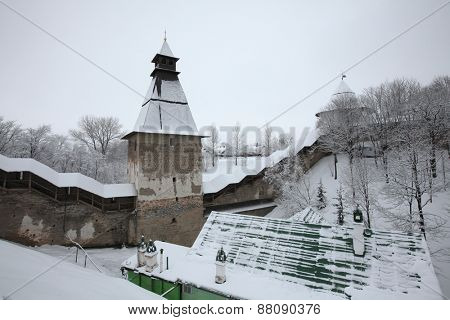 Russian winter. Towers and walls of the Pskovo-Pechorsky Monastery (Pskov Monastery of the Caves) near Pskov, Russia.