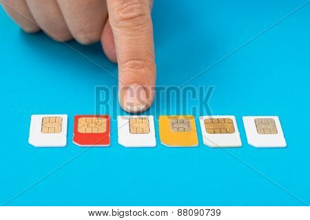 Person Hand Selecting Sim Card