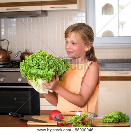 Young Girl With Fresh Lettuce. Healthy Food - Vegetable Salad. Diet. Dieting Concept. Healthy Lifest