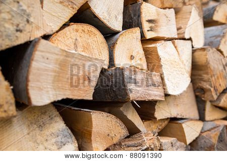 Dry chopped firewood logs ready for winter. Selective focus