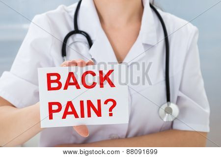Doctor Holding Placard With Back Pain Text