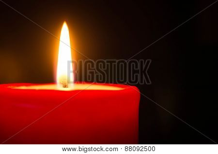 Red Candle Against A Dark Background