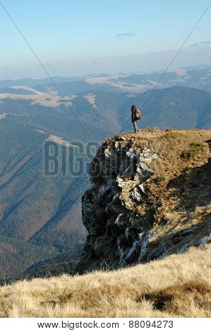 Woman Admiring Landscape From The Top Of The Mountain