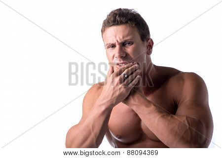 Muscular handsome man holding his jaw for toothache with one hand