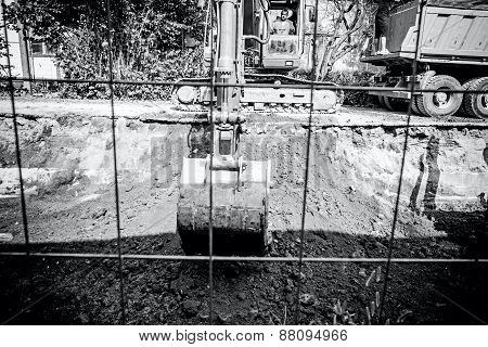 Excavator Digging Trench
