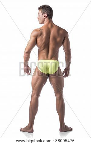 Full body shot, back of muscular young man standing