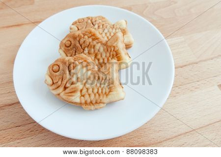 Japanese fish-shaped cake Taiyaki on the plate