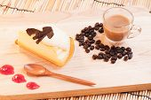 stock photo of custard  - cheese custard cake and cup of coffee on wood - JPG