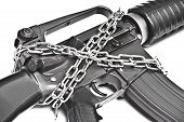 foto of rifle  - a chained rifle representing the control of gun usage - JPG