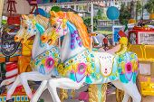 picture of carousel horse  - Two horses on a carousel at fairground for children - JPG