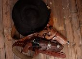 picture of pistols  - A cowboy hat and pistol on a wooden background - JPG