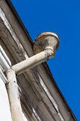 picture of downspouts  - Rain gutters on old home - JPG