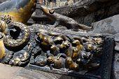 stock photo of metal sculpture  - Brass animal sculptures on a public fountain - JPG
