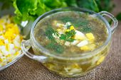stock photo of sorrel  - green soup with eggs and sorrel in a plate