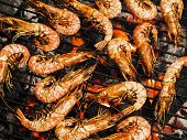 foto of barbecue grill  - Shrimps on barbecue grill Grilling with coal - JPG