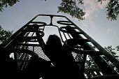 picture of climb up  - Silhoutte of Lucy climbing up a climbing frame - JPG