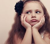 picture of sad faces  - Cute girl looking sad with pouted lips and hands under face - JPG