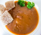 pic of creole  - Cuban cuisine: red kidney beans soup surfce taken with wide angle lens and white background. ** Note: Shallow depth of field - JPG