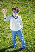 stock photo of rapture  - Cheerful little boy having relax outdoors during his summer vacation - JPG