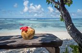 picture of pina-colada  - Pina colada in coconut on the tropical beach Seychelles - JPG