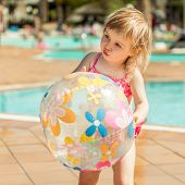 pic of pool ball  - little cute girl playing near the pool with a ball - JPG