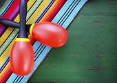image of maracas  - Happy Cinco de Mayo background with colorful maracas on Mexican theme dark green distressed table with copy space - JPG