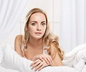 picture of early morning  - young woman laying in bedroom at early morning - JPG