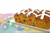 stock photo of easter candy  - Homemade Easter hot cross buns with holiday candy eggs. ** Note: Soft Focus at 100%, best at smaller sizes - JPG