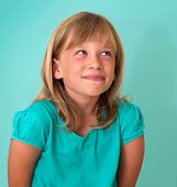 image of cunning  - Cute cunning little girl isolated on turquoise background - JPG