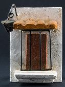 foto of pumice-stone  - lamppost above door with iron grill pumice - JPG