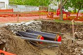 pic of sandbag  - Newly laid pipe are passing under the road trough sandbag wall in trench - JPG