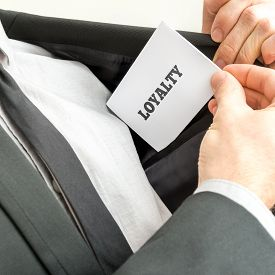 stock photo of loyalty  - Businessman showing a white card reading  - JPG