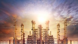 stock photo of tubes  - exterior tube of petrochemical plant and oil refinery for produce industrial matterial in heaviy petroleum industry estate against beautiful sun light sky - JPG