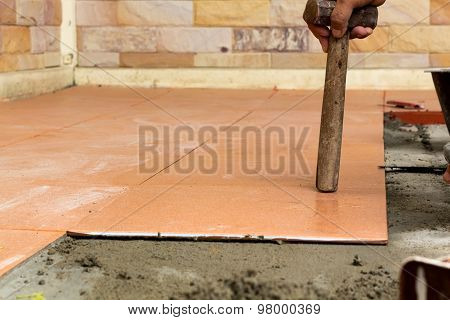 Man Construction Worker Is Tiling At Home, Tile Floor Adhesive Renovation At Home