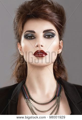 Beautiful Girl in the Gothic style with bright makeup. Beauty face.