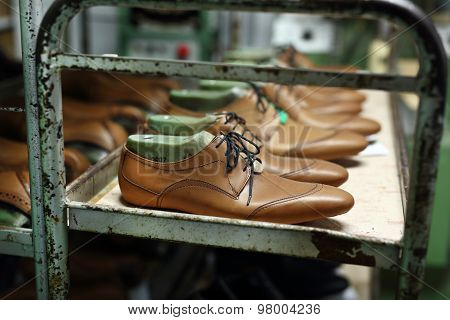Classic men's elegance, stitched shoes at the cobbler