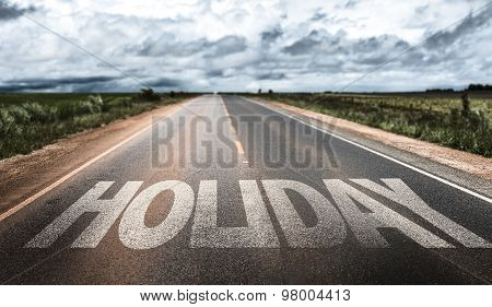 Holiday written on rural road
