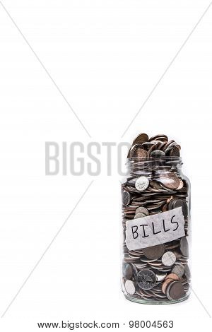 A full glass jar with Bills label