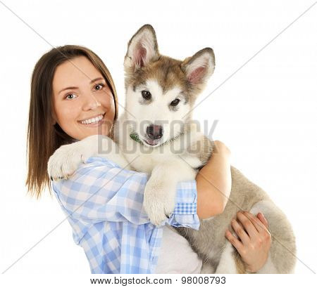 Young woman with malamute puppy isolated on white