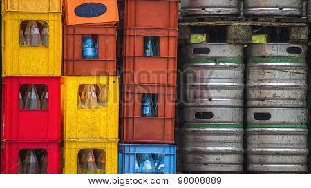 Plastic Crates Of Empty Bottles Tin Kegs Of Beer